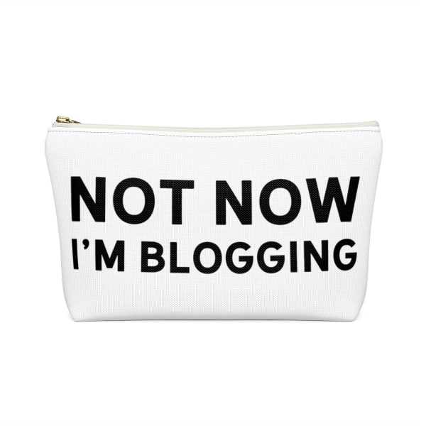 """Need an accessory pouch to store your make-up or an adorable travel bag to carry to the coffee shop with you? Check out our blogging bags collection (including this double-sided """"Not Now I'm Blogging"""" print) and find more gift ideas for bloggers! Funny gift idea for bloggers, office gift idea, make-up pouch, photography prop bloggers."""